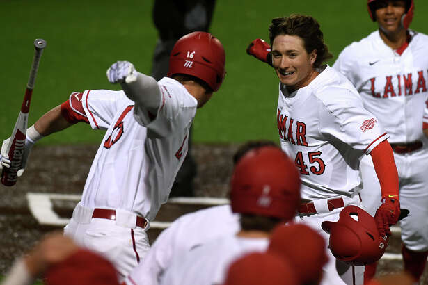 Lamar's Cole Secrest, right, celebrates with Anthony Quirion after Secrest hit a home run that brought two others home against the Blackbirds during the Cardinals' season-opener Friday night.
