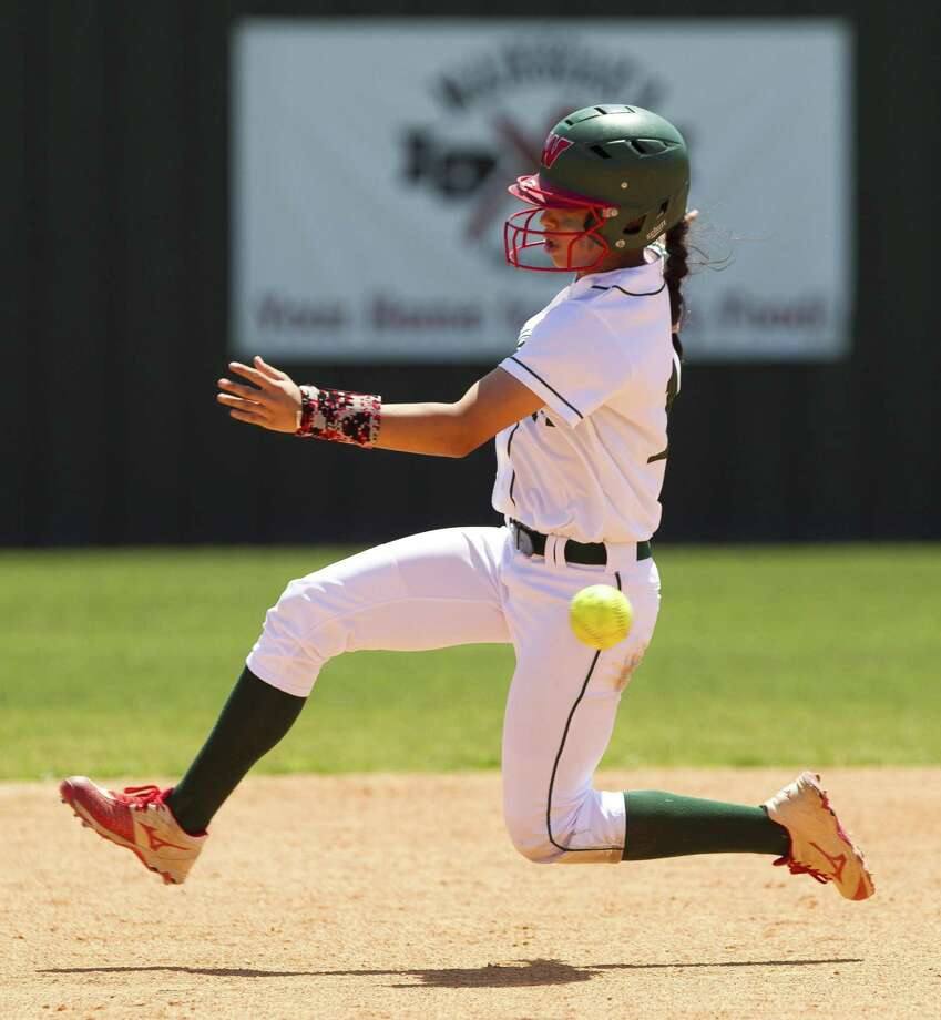 Ariel Gomez #14 of The Woodlands tries to beat the throw to North Mesquite shortstop Avery Valdez (22) during the second inning of a Region II-6A bi-district playoff series, Saturday, April 28, 2018, in The Woodlands. Photo: Jason Fochtman, Staff Photographer / Houston Chronicle / © 2018 Houston Chronicle