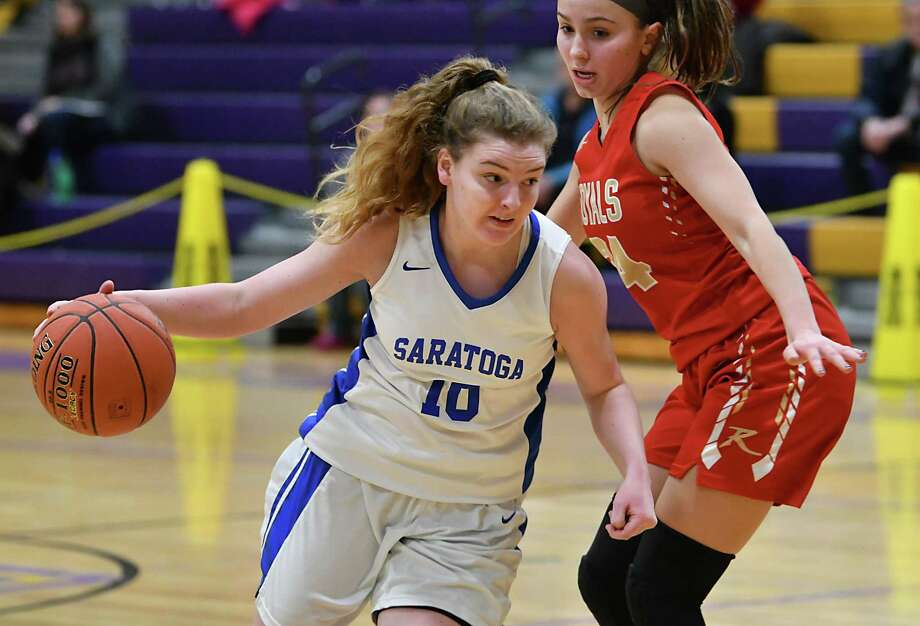 Saratoga's Kerry Flaherty, #10, dribbles by Holy Redeemer's Jordan Cicon as she drives to the hoop during a basketball game on Friday, Dec. 28, 2018 in Amsterdam, N.Y. (Lori Van Buren/Times Union) Photo: Lori Van Buren / 20045805A