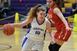 Saratoga's Kerry Flaherty, #10, dribbles by Holy Redeemer's Jordan Cicon as she drives to the hoop during a basketball game on Friday, Dec. 28, 2018 in Amsterdam, N.Y. (Lori Van Buren/Times Union)