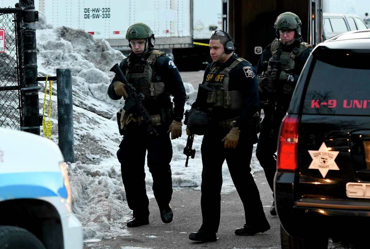 Law enforcement officers work at the scene of a shooting at the Henry Pratt Co. on Friday, Feb. 15, 2019, in Aurora, Ill. Officials say several people were killed and at least five police officers were wounded after a gunman opened fire in an industrial park. (AP Photo/Matt Marton)