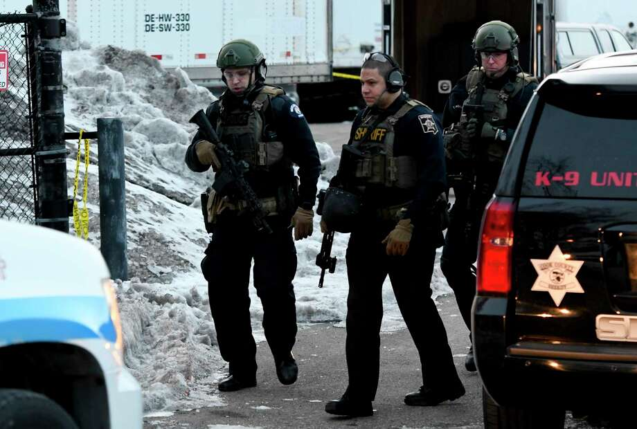 Law enforcement officers work at the scene of a shooting at the Henry Pratt Co. on Friday, Feb. 15, 2019, in Aurora, Ill. Officials say several people were killed and at least five police officers were wounded after a gunman opened fire in an industrial park. (AP Photo/Matt Marton) Photo: Matt Marton / Copyright 2019 The Associated Press. All Rights Reserved.
