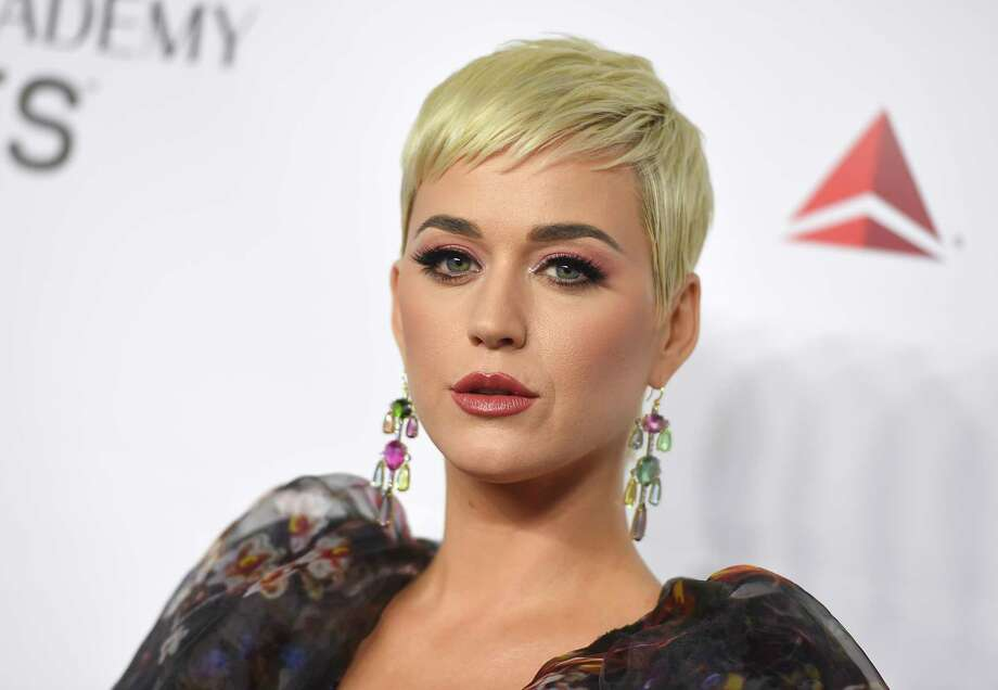 FILE - In this Feb. 8, 2019 file photo Katy Perry arrives at MusiCares Person of the Year honoring Dolly Parton in Los Angeles. Perry's fashion line has pulled two types of shoes after some people compared them to blackface. The Ora Face Block Heel and Rue Face Slip-On Loafers were released last summer in nine different colors. They included protruding eyes, nose and red lips. (Photo by Jordan Strauss/Invision/AP, File) Photo: Jordan Strauss / 2019 Invision