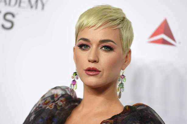 FILE - In this Feb. 8, 2019 file photo Katy Perry arrives at MusiCares Person of the Year honoring Dolly Parton in Los Angeles. Perry?'s fashion line has pulled two types of shoes after some people compared them to blackface. The Ora Face Block Heel and Rue Face Slip-On Loafers were released last summer in nine different colors. They included protruding eyes, nose and red lips. (Photo by Jordan Strauss/Invision/AP, File)