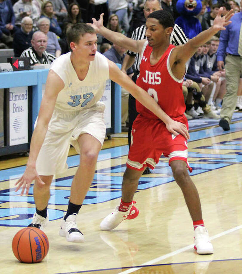 Jersey's Tucker Shalley (left), scored 18 points in Friday night's 56-50 loss at Highland. He is shown in action earoier this season. Photo: Telegraph