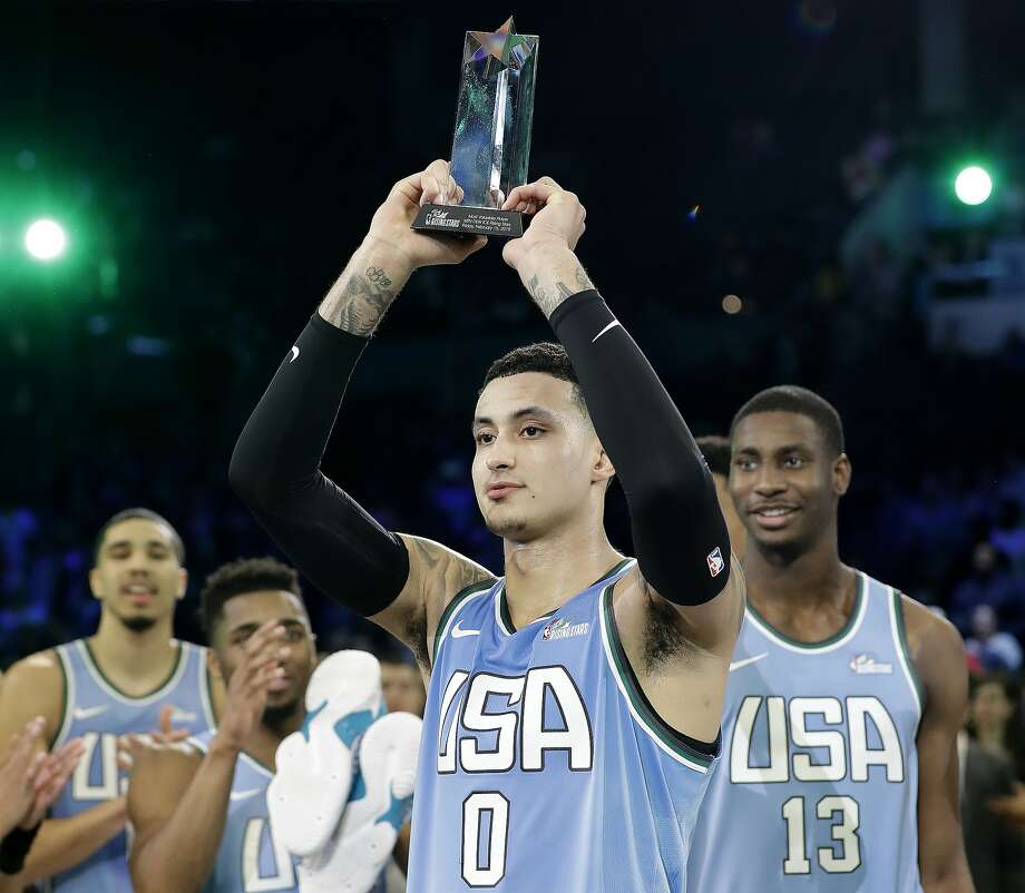 LaU.S. Team's Kyle Kuzma, of the Los Angeles Lakers holds the MVP trophy after the NBA All-Star Rising Stars basketball game between the World Team and the U.S. Team, Friday, Feb. 15, 2019, in Charlotte, N.C. The U.S. Team won 161-144. (AP Photo/Chuck Burton) Photo: Chuck Burton / Associated Press