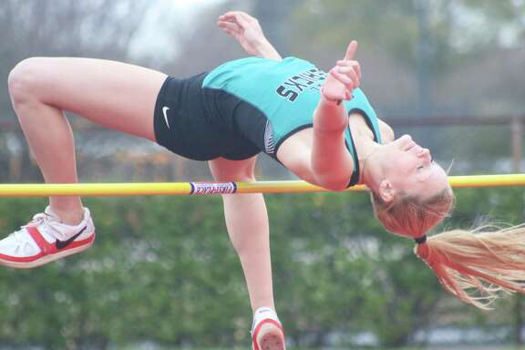 Memorial' High School high jumper Brandi Hemminger has room to spare on this jump during the event at Friday's Brown Relays. Hemminger cleared 4-10, but no further. Dickinson jumper LaRiah Shannon tried to tie a 29-year-old record, but had to settle for 5-7.