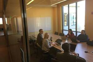 Staff members at Community eConsults Network, a nonprofit company creating a platform for electronic medical consultations, meet at the newly opened technology building in Middletown for for Community Health Center Inc. and the Weitzman Institute, which spun off eConsults.