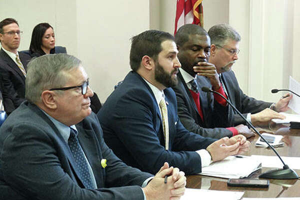 Supporters of a bill to provide equal parenting time for divorcing couples include psychologist James Bedell (from left), Illinois Fathers for Equality President Chad Loudermilk, state Rep. La Shawn Ford and American Coalition for Fathers and Children Executive Director Michael McCormick. They spoke during a House subcommittee hearing in Springfield.