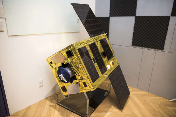 A prototype of the Astroscale Holdings ELSA-d in-orbit debris capture and removal craft displayed at the company's Japan unit office in Tokyo on Dec. 26, 2018.