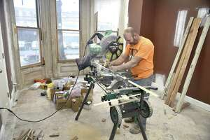 Carpenter Scott Fee, an employee of Window Master Real Wood Products of North Haven, cuts wood during the restoration 1389 Chapel St., New Haven, the future home of the Sickle Cell Disease Association of Southern Connecticut.