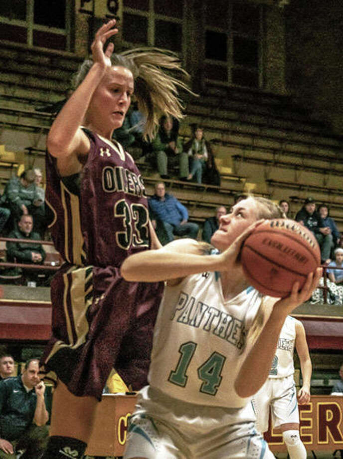 EA-WR's Fiona Hamiti (left) defends while Jersey's Lauren Brown looks to the basket during Tuesday's Class 3A regional semifinal at Memorial Gym in Wood River. The Oilers lost to the Panthers and finished the season with a 16-13 record. Photo: Nathan Woodside / The Telegraph