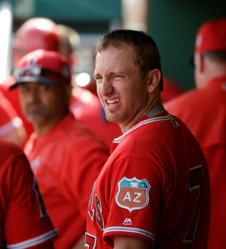 Los Angeles Angels shortstop Cliff Pennington stands in the dugout during a spring baseball game against the San Francisco Giants in Scottsdale, Ariz., Thursday, March 3, 2016. (AP Photo/Chris Carlson)