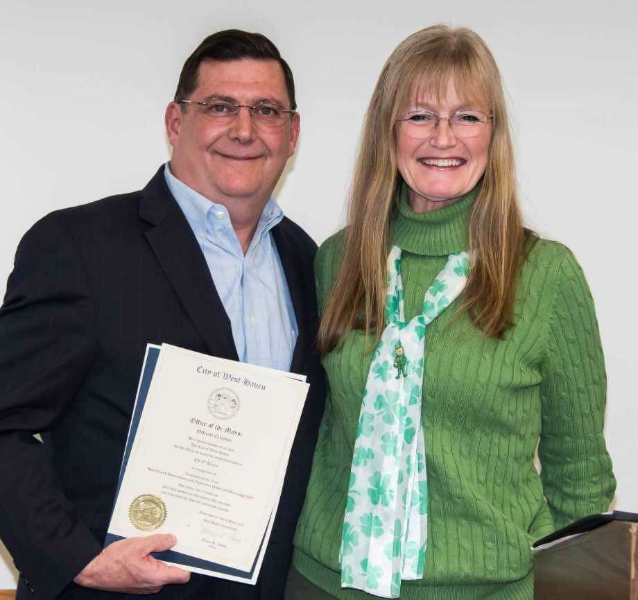 """Former Mayor Ed O'Brien and current Mayor Nancy Rossi in a rare photograph together when O'Brien was honored on March 10, 2018, as the West Haven Elk's Lodge's """"Irishman of the Year."""" As part of the ceremony, current Mayor Nancy Rossi presented O'Brien with a citation. Photo: Paul J. Rapanault / Contributed Photo"""