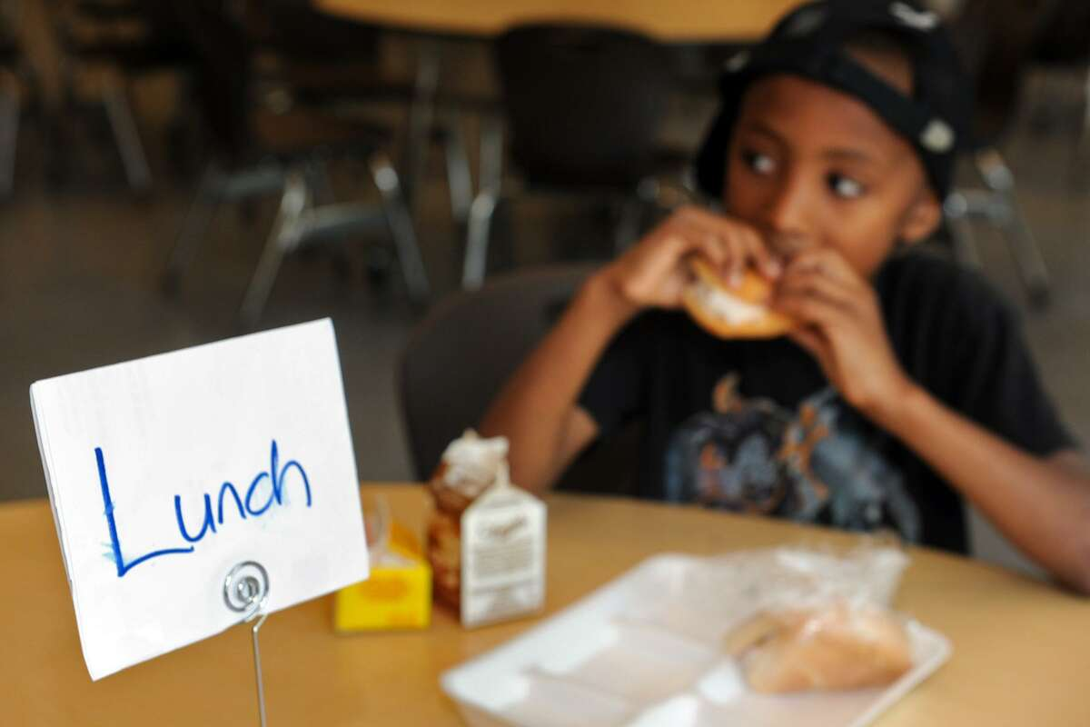 Adorian Campbell eats lunch in the cafeteria at Hamilton Avenue School, in Greenwich, Conn. July 30, 2014. Community breakfasts and lunches are available to school aged kids, part of the federally funded Seamless Summer Food Program.