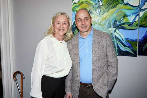 Barbara Marion of Greenwich and New York Yankees General Manager Brian Cashman at the Family Centers benefit in Darien last week.