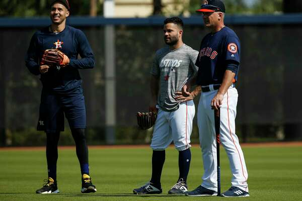 Houston Astros shortstop Carlos Correa, from left, second baseman Jose Altuve and manager AJ Hinch watch minor league field players batting at Fitteam Ballpark of The Palm Beaches on Day 3 of spring training on Saturday, Feb. 16, 2019, in West Palm Beach.