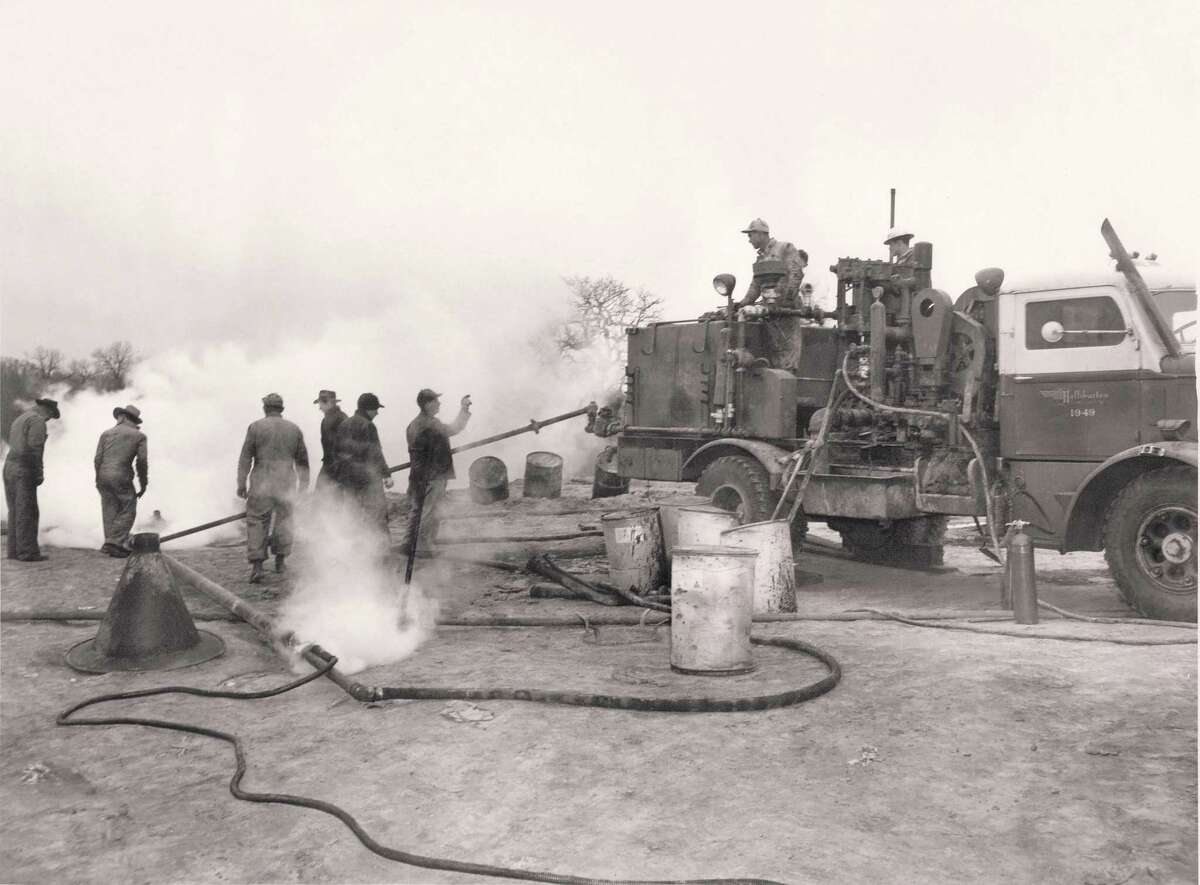 This decades-old photo shows a Halliburton crew working on a remote oil well. Founded in 1919, the Houston oilfield service company is celebrating its 100th anniversary in 2019.