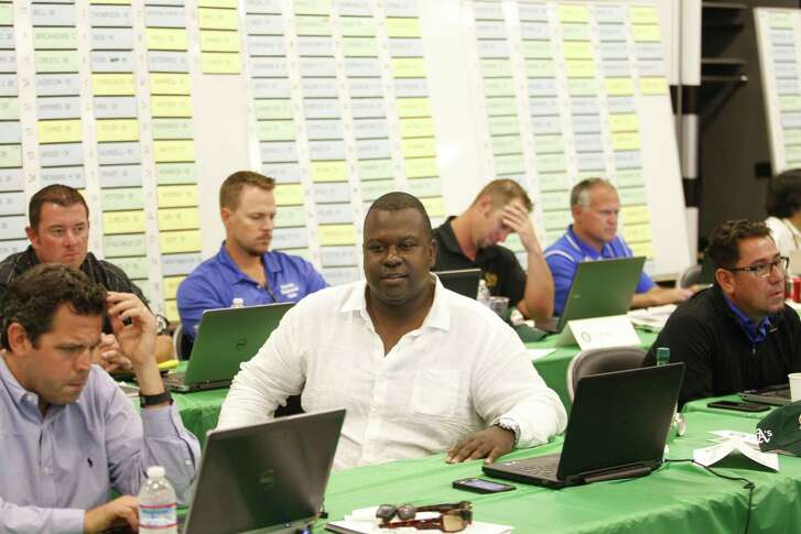 Director of Player Personnel Billy Owens of the Oakland Athletics sits in the Athletics draft room during the first day of the 2015 MLB Draft.