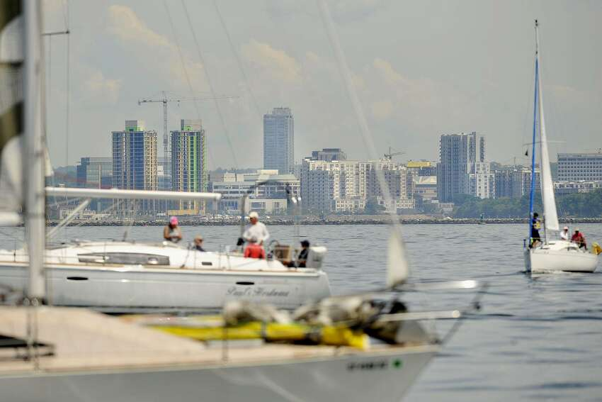 The Stamford skyline can be seen in the distance as a handful of sailboats prepare for the start of the 29th annual Mayor's Cup Race on the Long Island Sound off shore from Stamford, Conn., on Sunday, June 8, 2014. The sailboat regatta was later cancelled due to a lack of wind.