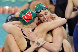 The Woodlands reacts after winning the Class 6A girls 200-yard medley relay during the UIL State Swimming & Diving Championships at the Lee & Joe Jamail Texas Swimming Center, Saturday, Feb. 16, 2019, in Austin.