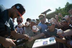 Houston Astros outfielder George Springer (4) signs auotographs for fans at Fitteam Ballpark of The Palm Beaches on Day 3 of spring training on Saturday, Feb. 16, 2019, in West Palm Beach.