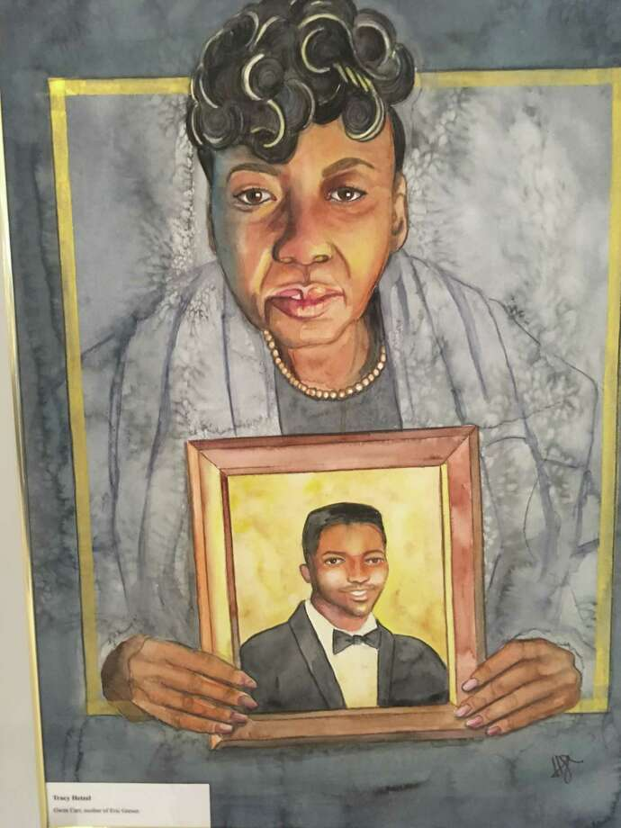 A portrait by artist Tracy Hetzel, of Gwen Carr holding a photo of her son Eric Garner, who died while being arrested by New York City police, was among those on view at the New York Civil Liberties Union booth on the Concourse of the Empire State Plaza in Albany during the New York State Association of Black and Puerto Rican Legislative Conference. Photo: Steve Barnes, Times Union