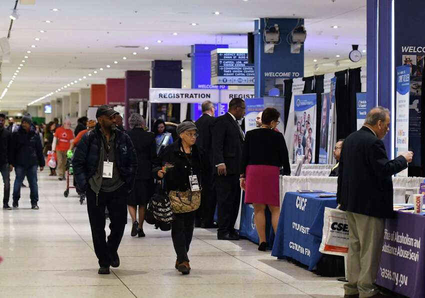 People browse various booths during the New York State Association of Black and Puerto Rican Legislators conference Saturday, Feb. 16, 2019 in the main concourse area in Albany, NY. (Phoebe Sheehan/Times Union)