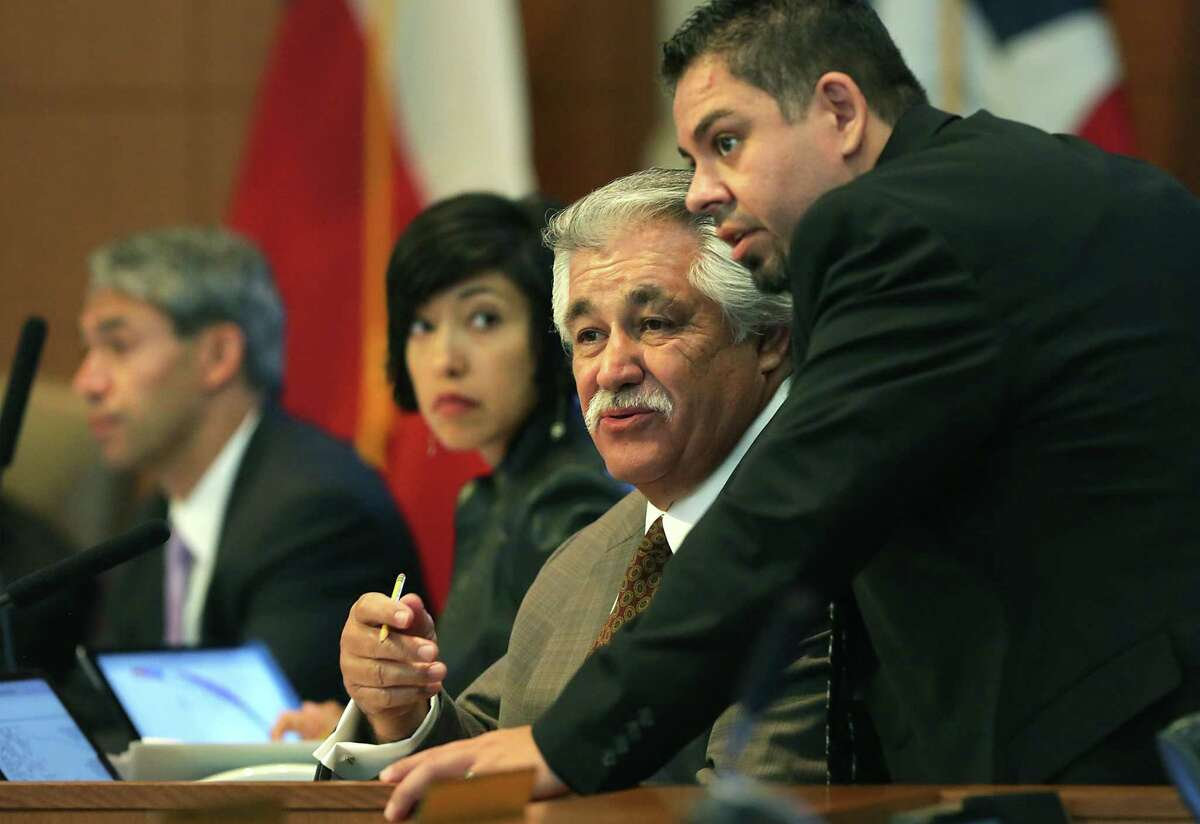 Outgoing council member Ray Lopez, center, confers with an aid during his final A session meeting on the current council in the Municipal Complex on Thursday, June 15, 2017.