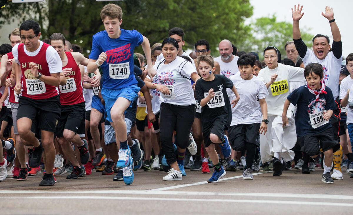 Runners take off from the starting line during the annual Steps for Students fun run and 5K race on Saturday, Feb. 16, 2019, in Houston. Steps for Students is an annual event benefiting the 59 Catholic schools in the Archdiocese of Galveston-Houston. More than 10,000 runners and walkers participated in the fund raising event benefiting Catholic education and services.