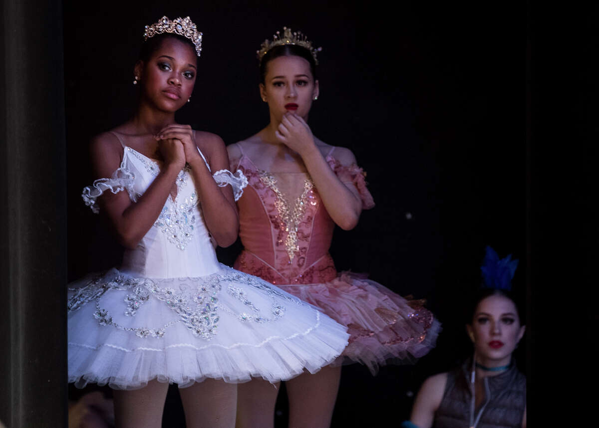 Dancers wait in the wings to go on stage to perform during the Youth America Grand Prix semi-finals at CullenPerformanceHall on Saturday, Feb. 16, 2019, in Houston. Hundreds of young ballet dancers - ages 9 to 19 - from all over Texas auditioned for the Youth America Grand Prix. Students are attending workshops, dance classes, and audition in hopes of making finals week in New York, where scholarships to top schools and companies will be awarded.