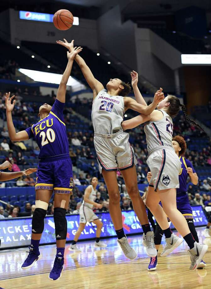 UConn's Olivia Nelson-Ododa (20) reaches for a rebound against East Carolina's Desiree Corbin (20) in a Feb. 6 game. Photo: Stephen Dunn / Associated Press / Copyright 2019 The Associated Press. All rights reserved