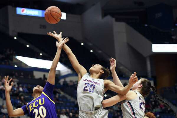 UConn's Olivia Nelson-Ododa (20) reaches for a rebound against East Carolina's Desiree Corbin (20) in a Feb. 6 game.