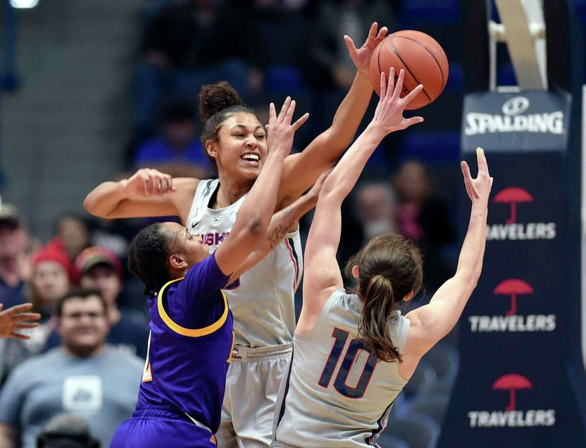 Connecticut's Olivia Nelson-Ododa (20) blocks a shot by East Carolina's Lashonda Monk (2) in the second half of an NCAA college basketball game against East Carolina Wednesday, Feb. 6, 2019 in Hartford, Conn. (AP Photo/Stephen Dunn)