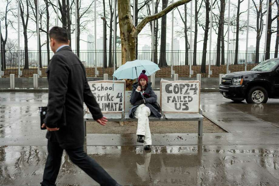 """Alexandria Villasenor, 13, skips school to strike in front of the United Nations, with signs reading: """"School Strike 4 Climate"""" and """"Cop24 Failed Us."""" Photo: Photo For The Washington Post By Sarah Blesener / COPYRIGHT SARAH BLESENER 2019"""