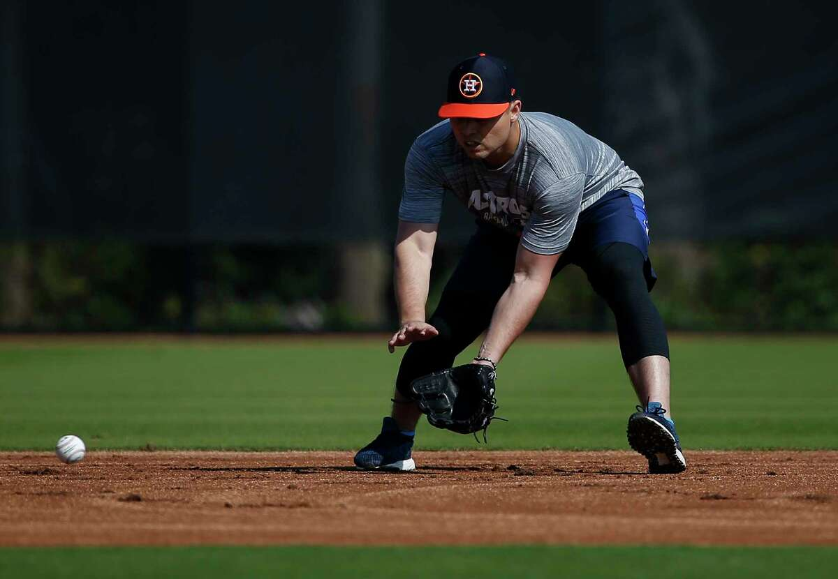 Houston Astros infielder Aledmys Diaz (16) works on ground ball at Fitteam Ballpark of The Palm Beaches on Day 3 of spring training on Saturday, Feb. 16, 2019, in West Palm Beach.