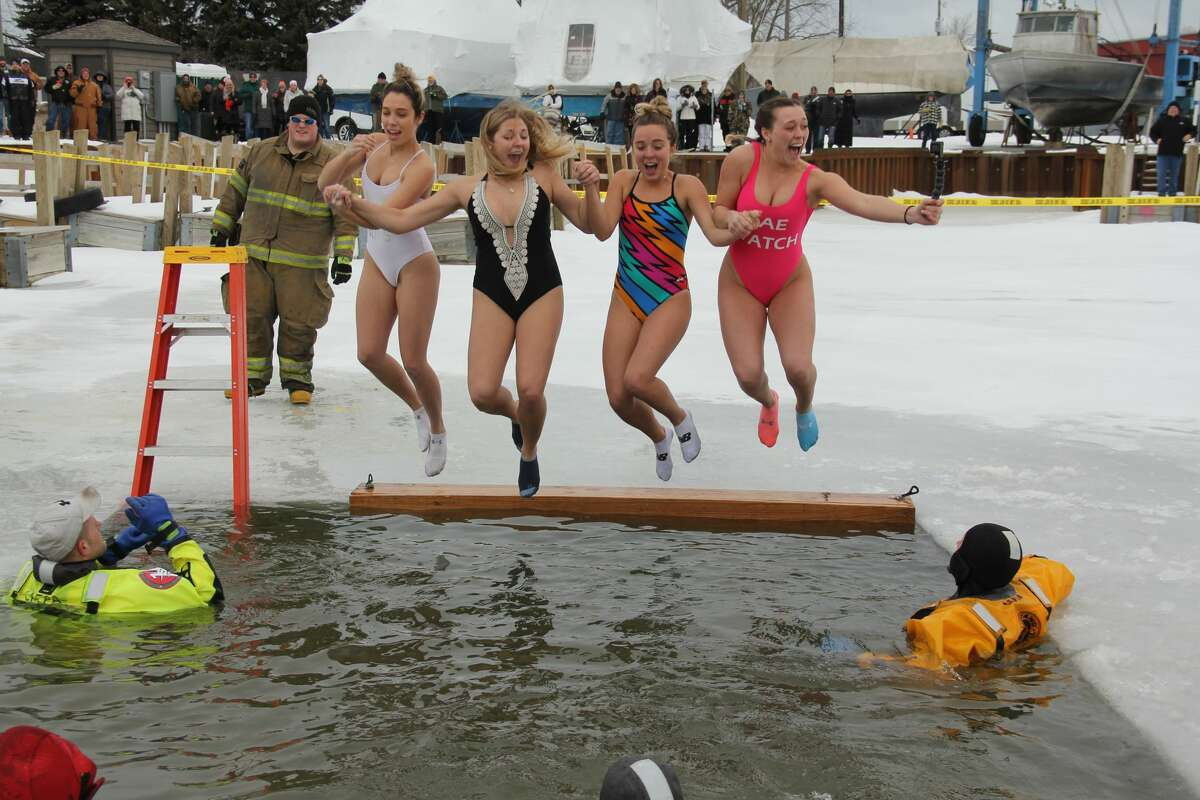 Scenes from the Polar Bear Dip, which was held at the Caseville Shanty Days on Saturday.