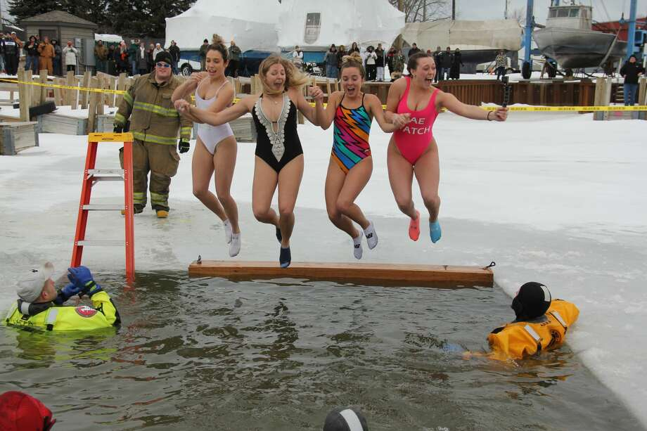 Scenes from the Polar Bear Dip, which was held at the Caseville Shanty Days on Saturday. Photo: Mike Gallagher/Huron Daily Tribune