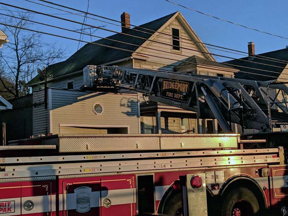 The fire broke out at a 2.5-story residence in the 100 block of Bond Street in Bridgeport, Conn., in Feb. 16, 2019. Multiple calls to 911 were made about a fire on the second floor of the building, possibly in the rear of the house, dispatch reports indicated. Photo: Contributed Photo / Contributed Photo / Connecticut Post Contributed
