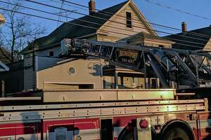 The fire broke out at a 2.5-story residence in the 100 block of Bond Street in Bridgeport, Conn., in Feb. 16, 2019. Multiple calls to 911 were made about a fire on the second floor of the building, possibly in the rear of the house, dispatch reports indicated.