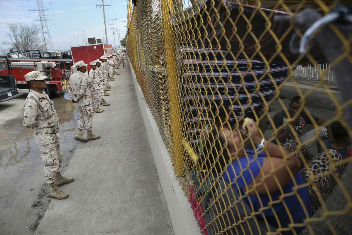 Mexican military personnel guard a shelter housing over 1,900 Central American immigrants in Piedras Negras, Mexico, Wednesday, Feb. 6, 2019. The immigrants arrived in the border town on Monday. Most are looking to seek asylum in the U.S. The town is across the Rio Grande from Eagle Pass, Texas.