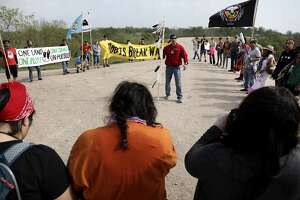 Mekasi Camp Horinek of the Ponca Nation leads a group of Native Americans during a march with supporters of the National Butterfly Center on the levee in the National Butterfly Center on Monday, Feb. 4, 2019.
