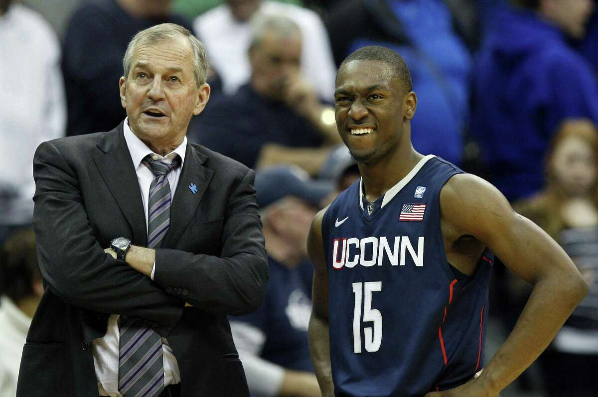 Connecticut coach Jim Calhoun, left, stands with player Kemba Walker during a game against Seton Hall in February 2011.