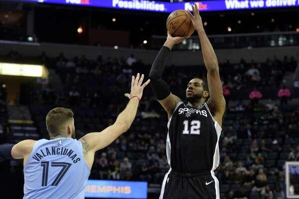 San Antonio Spurs center LaMarcus Aldridge (12) shoots over Memphis Grizzlies center Jonas Valanciunas (17) during the second half of an NBA basketball game Tuesday, Feb. 12, 2019, in Memphis, Tenn. (AP Photo/Brandon Dill)