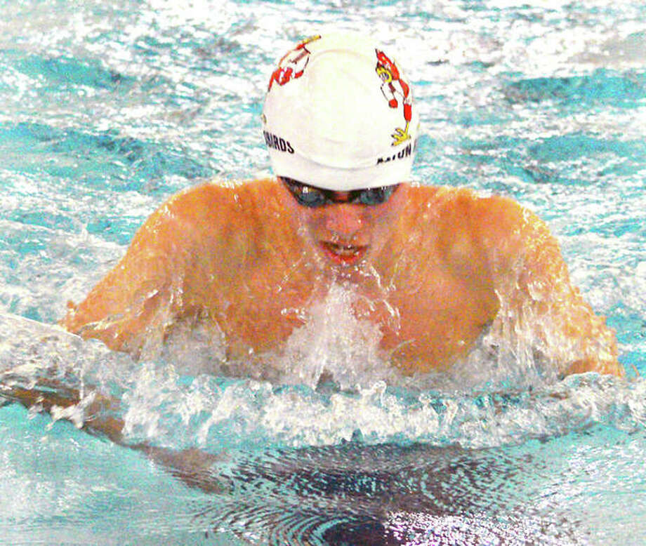 Alton's Noah Clancy heads for the wall on his way to a first-place finish in the 100-yard breaststroke at Saturday's Edwardsville Boys Swim and Dive Sectional Meet at the Chuck Fruit Aquatic Center. Photo: Scott Marion   Hearst Illinois