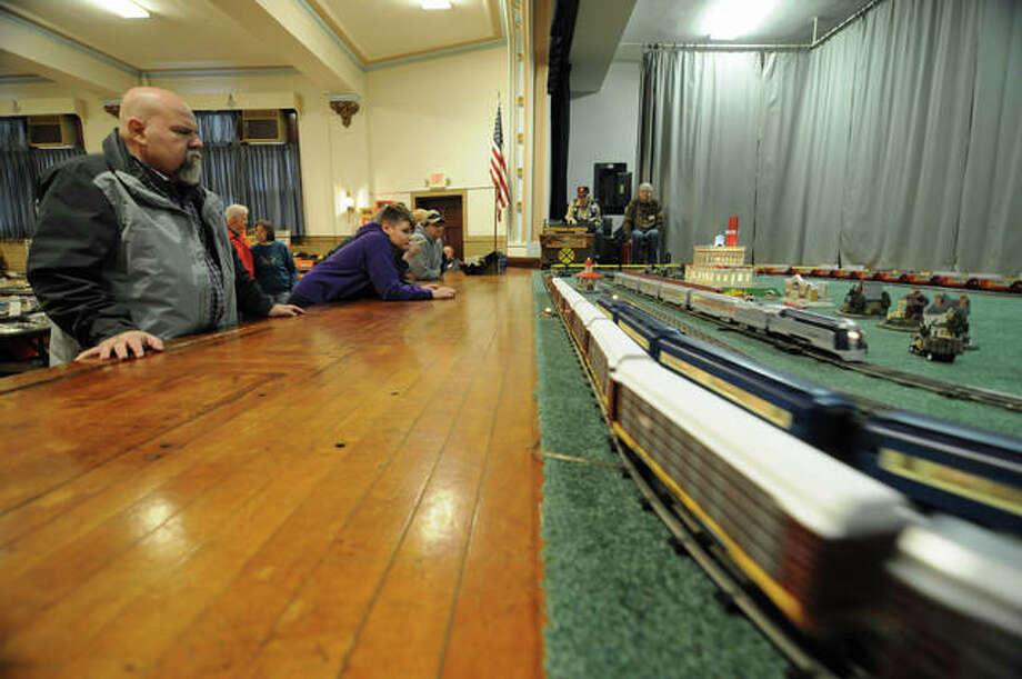 Visitors watch the large operating layout during Saturday's Alton Train Show. Photo: David Blanchette | For The Telegraph
