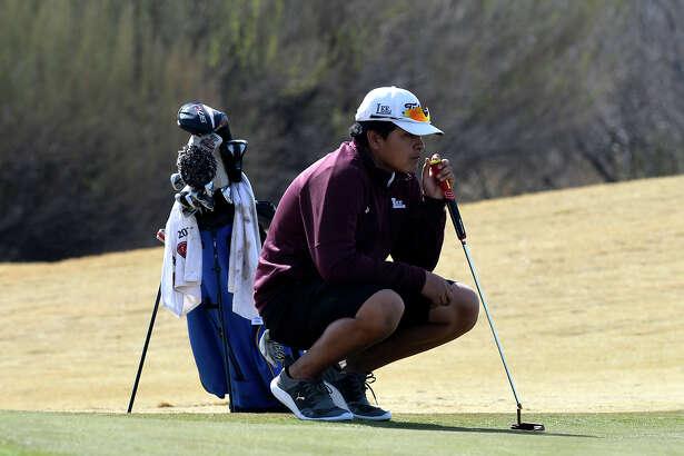 Lee's Eli Martinez reads the green during the Tall City Golf Invitational Feb. 16, 2019 at Hogan Park Golf Course. James Durbin/Reporter-Telegram