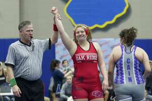 Oak Ridge's Amber Latta reacts after winning the girls 215-pound final during the District 8-6A wrestling championships at Klein High School, Thursday, Feb 7, 2019, in Klein.