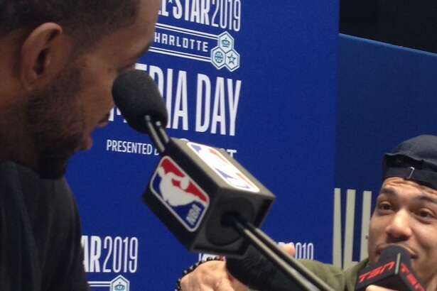 Danny Green interviews his former Spurs teammate LaMarcus Aldridge on Saturday at NBA All-Star Weekend in Charlotte.