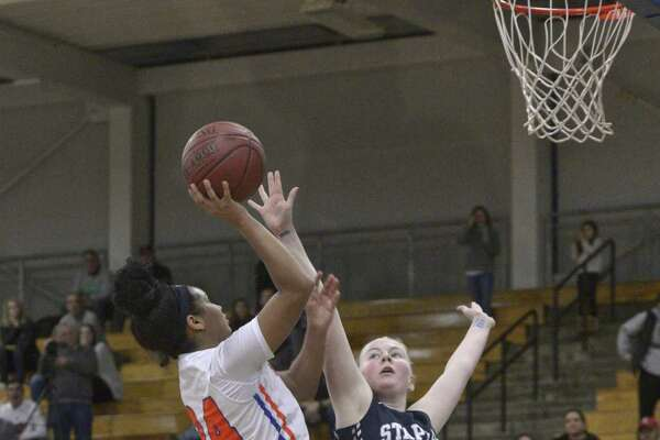 Danbury's Ty'Lynn Ith (24) shoots over Staples Alva Nordin (14) in the FCIAC girls basketball tournament quarterfinal game between Staples and Danbury high schools, Saturday, February 16, 2019, at Fairfield Ludlowe High School, Fairfield, Conn.